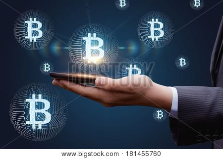 Hand With Mobile Phone And Bit Coin .