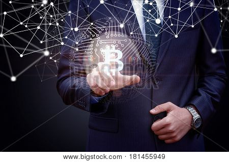 Business Man Presses Bit Coin Button.