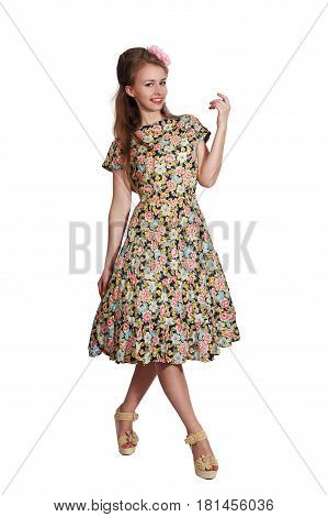 Beautiful woman in a gray dress, fashion in the sixties style