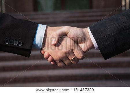 Business panorama. Business firm handshake. Business agreement. Handshake on background bank. Shake hands with each other. Business friendship partners. Business concept. Business man. Business idea. Business people