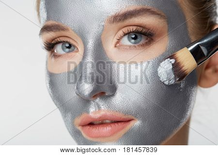 Woman portrait skin care health healthy silver mask close up white smilling amusing