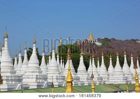 Large stupa forest of the Sandamuni Paya pagoda and Mandalay Hill, Myanmar (Burma)