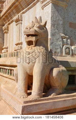 Statue of mystery lion on territory of temple in Bagan, Myanmar (Burma)