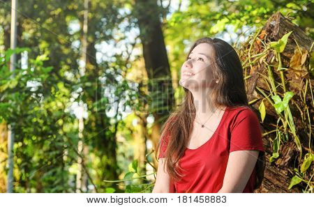 Happy Woman With A Cute Smile Looking Up To The Sky
