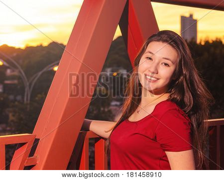 Happy Woman With A Cute Smile At A Warm Sunset