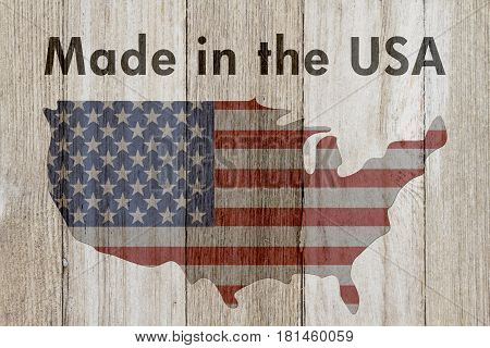 Made in the USA message USA patriotic old flag on a map and weathered wood background with text Made in the USA