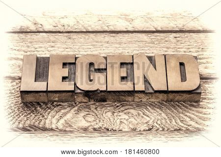 legend word in vintage letterpress wood type, sepia toning