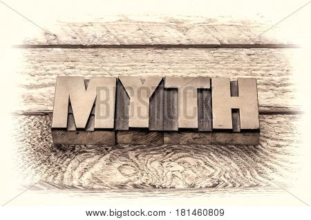myth word in vintage letterpress wood type, sepia toning