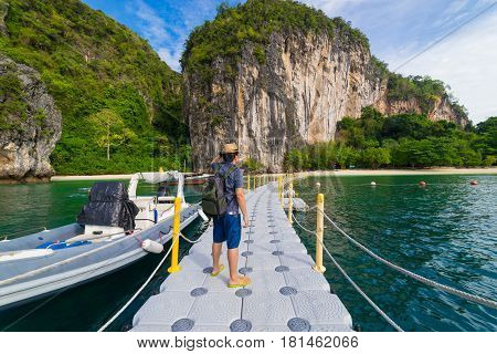 Traveler Summer concept - Young man traveller traveling to Hong Islands in andaman sea Krabi South of Thailand.