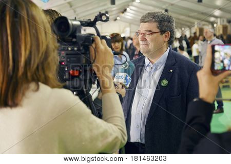 BILBAO SPAIN - APRIL 13 2017: Juan Maria Aburto Mayor of the city of Bilbao being interviewed during the Basque fest 2017.