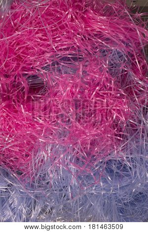 This is a photograph of Pink and Blue shredded plastic fake Easter grass background