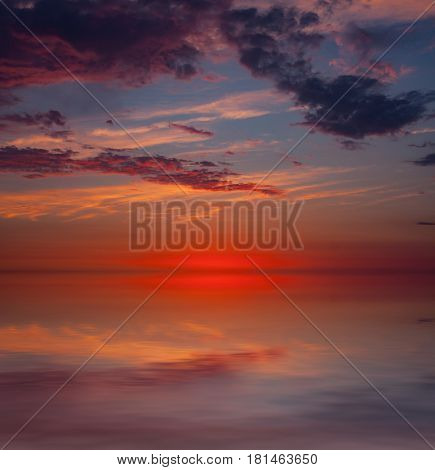 Abstract sunset scene over water surface
