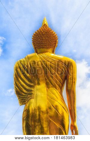 Golden Buddha Statue and blue sky in thai temple Wat Phra That Khao Noi in Nan province Northern of Thailand