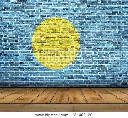Palau flag painted on brick wall with wooden floor