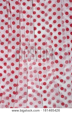 This is a photograph of Red Polka dot Crepe paper streamers
