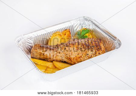 Close Up Healthy Restaurant Food Delivery In Foil Box. Grilled Meat Steak And Potato Wedges. Meals T