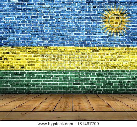 Rwanda flag painted on brick wall with wooden floor