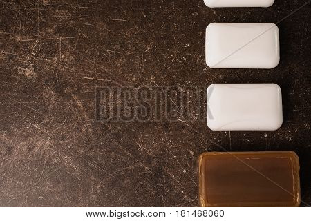 Tar soap and white soap on a dark marble background. Personal care. Hygiene