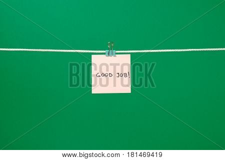 Pink Paper Sheet On The String With Text Good Job