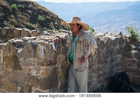 Oaxaca, Mexico, circa february 2017: Mexican man in Monte Alban, a large pre-Columbian archaeological site in Oaxaca, Mexico