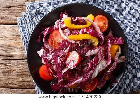 Radicchio Salad With Tomatoes And Sweet Peppers Closeup. Horizontal Top View