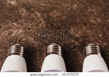 LED light bulb on a dark marble background. To save energy. Eco concept