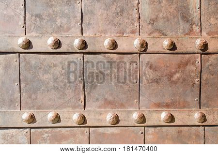 Old forged iron doors. Close-up. Horizontall. Outdoors.