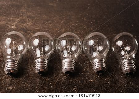 Light bulb on a dark marble background. To save energy. Eco concept
