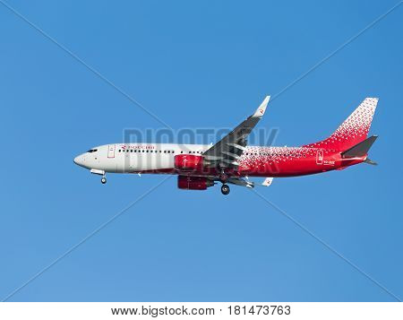 Sochi - April 3 2017: Powerful passenger plane Boeing 737-8GJ Russia the airline lands at Sochi airport in the evening against a clear blue sky April 3 2017 Sochi Russia