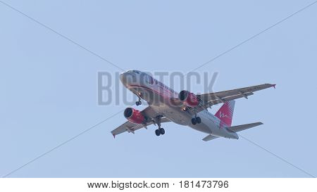 Sochi - April 3 2017: Passenger plane Airbus A319-111 Vim Airlines makes a landing at Sochi airport in the evening against a clear blue sky April 3 2017 Sochi Russia