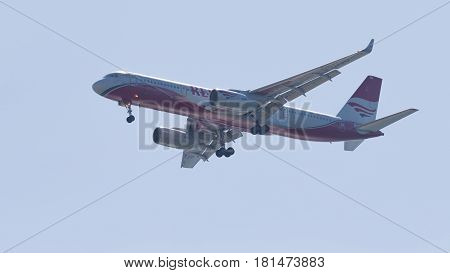 Sochi - April 3 2017: A powerful passenger aircraft Tupolev TOT-204-100V / E Red Wings airline makes a landing at the airport in Sochi in the evening against a clear blue sky April 3 2017 Sochi Russia