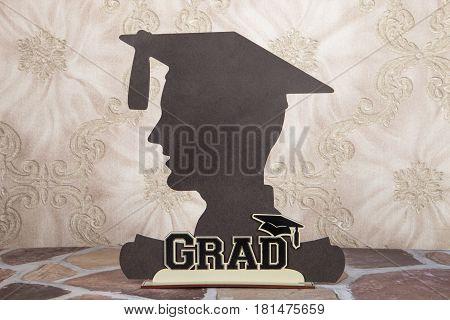 A still life of a male graduate silhouette