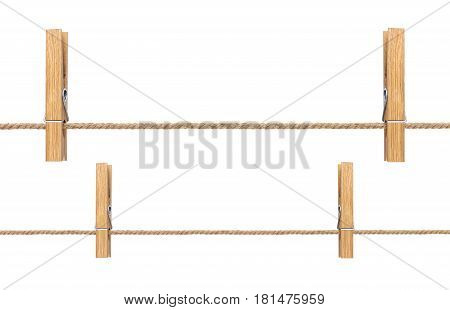 Isolated clothespins. Wooden clothespins on rope isolated on white background and clipping path
