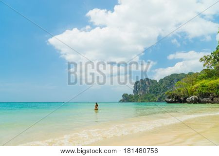 Woman on the beach in Railay West beach in Ao Nang, Krabi province, Thailand