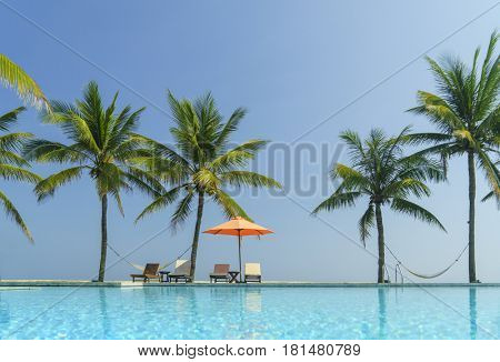 Swimming pool and beach at luxury hotel