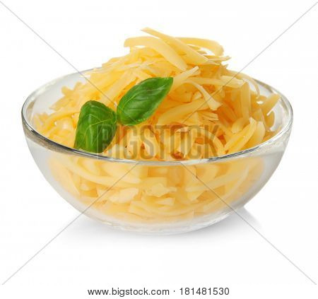 Glass bowl with grated cheese on white background