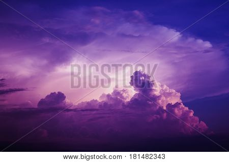 Blue sky with white and blue and pink clouds. Clear sky. Bird in the sky. Colorful sky. Pink and red sky
