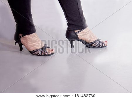 Woman dancing with black shiny salsa sandals