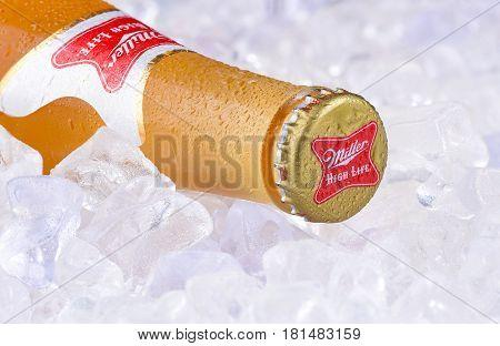 IRVINE CA - APRIL 10 2017: Miller High Life bottle on ice. High Life a pilsner style beer is Millers oldest brand entering the market in 1903