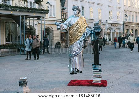 Austria, Salzburg, January 01, 2017: Man is a statue floating in the air. Entertainment of tourists in the town square in Salzburg - hometown of Mozart. Vacation, holidays, attractions.