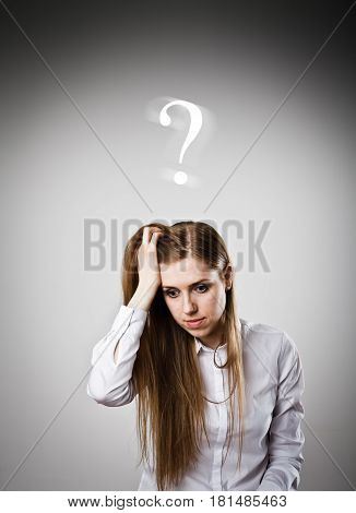 Girl in white is full of doubts and hesitation. Girl and question mark above her head.