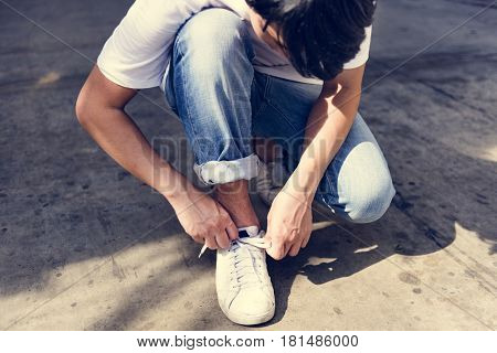 Asian Guy Sit Tie Shoelaces