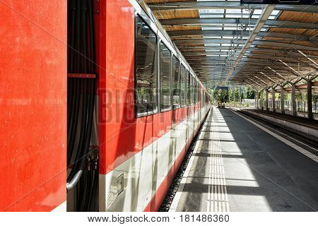 Zermatt, Switzerland - August 24, 2016: Concourse and train at Railway train station of Zermatt Valais canton in Switzerland.