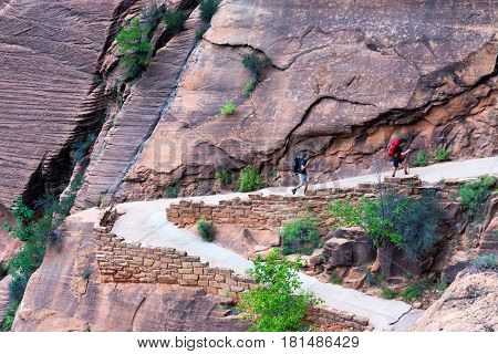 ZION NATIONAL PARK UT - SEPTEMBER 14: Hikers hike in Zion National Park in Utah on September 14 2015