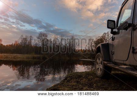 American SUV on a forest road, Leningrad region, Russia
