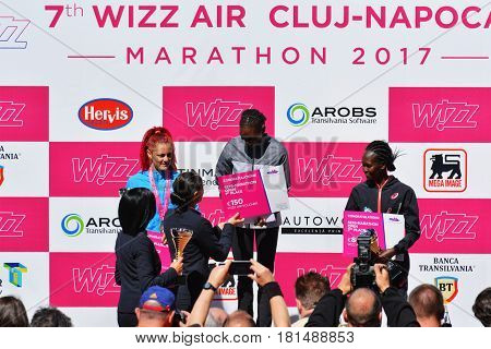 CLUJ-NAPOCA ROMANIA - APRIL 9 2017: Winners award ceremony in Cluj Arena Stadium. Winner athletes are receiving their awards thophies and prices at the Wizz Air Cluj-Napoca Marathon.