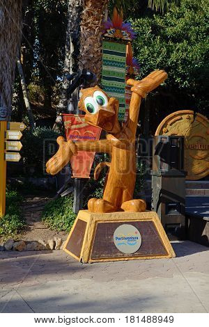 PORT AVENTURA SPAIN - MAY 26: The wooden duck statue is in Port Aventura theme park in May 26 2015 in Salou Spain. The park has a highest rollercoaster in Europe with 76m.