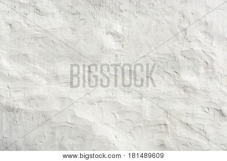 White stucco wall Grunge background. Old rough plastered Wall