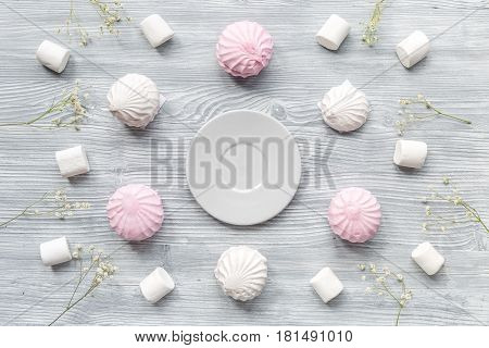 sweet marsh-mallow pattern for woman morning trendy design in soft light on wooden desk background top view