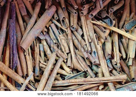 Cheap cinnamon sticks for sale in the most famous market in Chinatown district, Bangkok, Thailand. Texture of cinnamon sticks. Top view. Selective focus